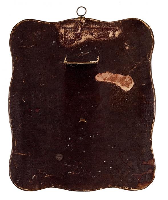 Неизвестный автор «Мужской портрет». 1880-е. Раскрашенная фотография. Рамка— кожа, тиснение, латунь. Размер 32x27см.