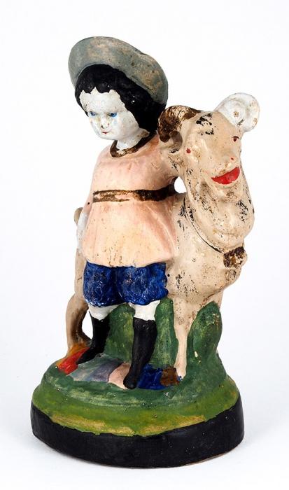 Скульптура «Мальчик скозликом». Россия, Гжель, кустарные артели. 1900-е. Керамика, холодные эмали. Размер 22x13x9,5см.